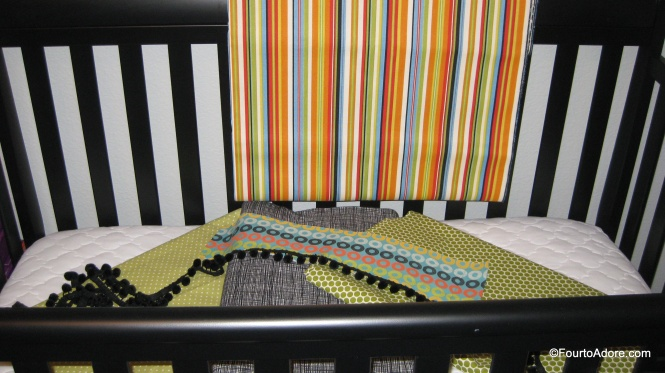 This is the boys' fabric swatches.  The bold stripe became their dust ruffle while the polka dots were for their curtains with pom pom embellishments.  The black flannel and greed polka dot fabrics are now their sheets.