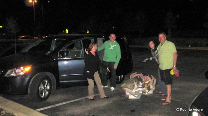 How many adults does it take to load a van with quadruplets?