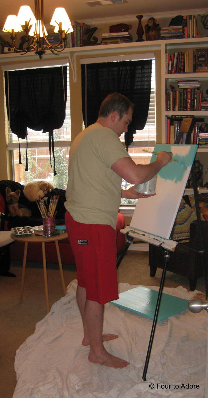 Here is the artist at work.  I thought this was the best scene.  George is here painting with a view of a snow dusted lawn and our dogs snuggled on the chaise lounge.