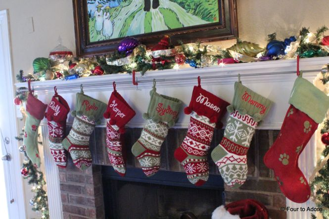 A year ago I never would hava imagined we would have EIGHT stockings hanging along our mantle.  We used a curtain rod and brackets to hand them instead of stocking holders.  It worked great for so many stokings.