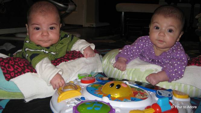 Harper and Rylin are also trying supported tummy time with a flashy button toy.