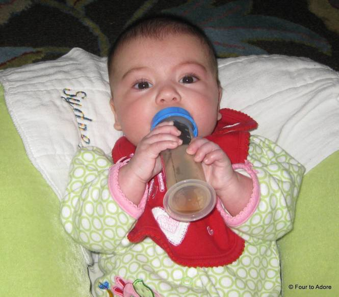 Rylin learned to hold her own juice bottle in the morning.
