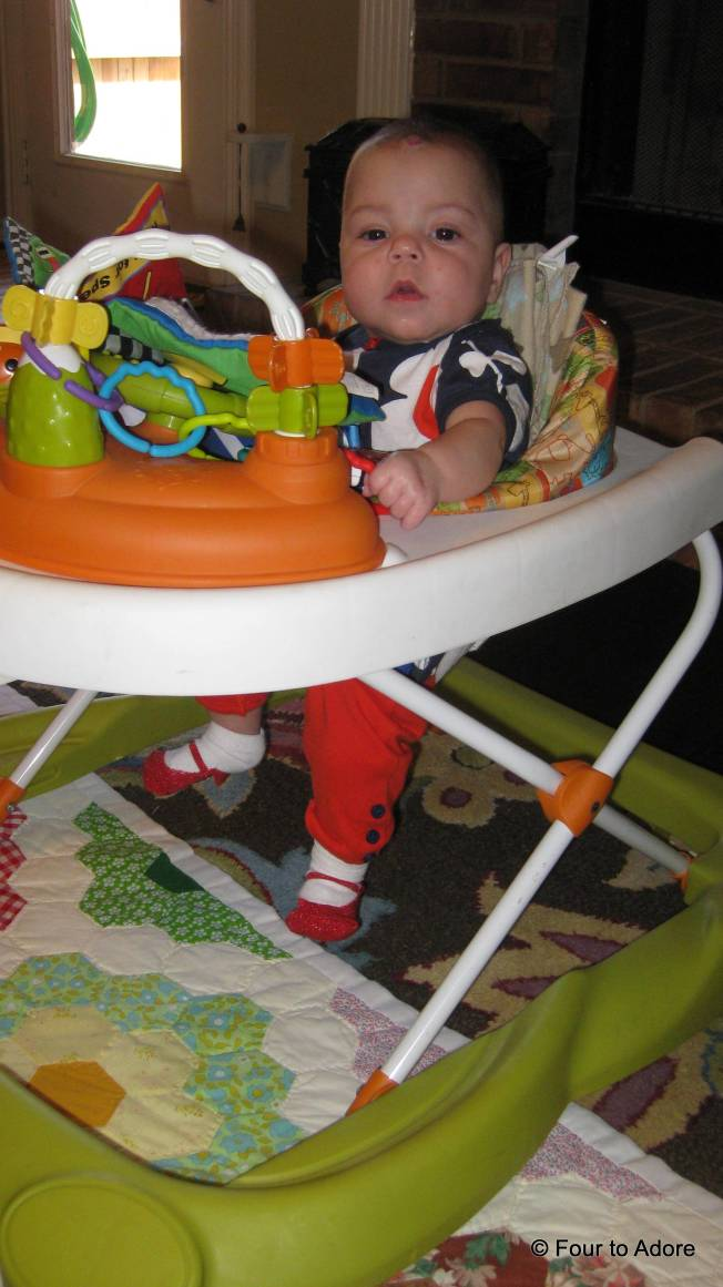 Sydney loves to stand, but poor baby can't reach the floor in these standing toys.