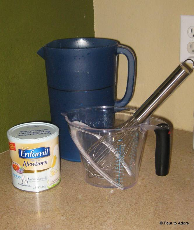 This is what we use to make our batches of formula: gallon sized pitcher, quart sized measuring cup, large whisk, and can of formula.
