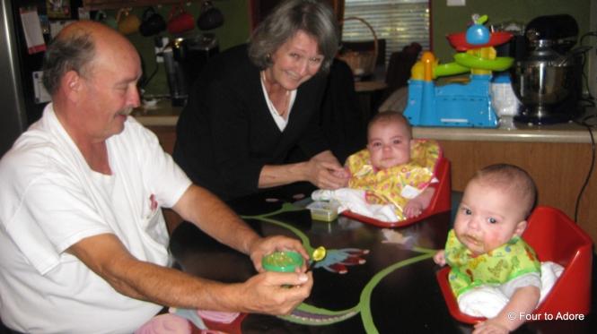 Carol feeding HarperGeorge feeding Mason
