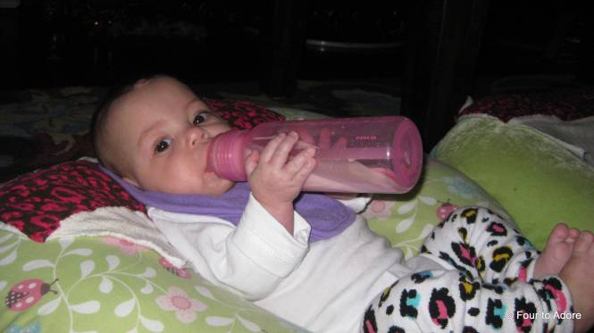 For the first time ever, Sydney put her hands ON her bottle.  She of course has not done it since this photo was taken, but hey she can do it!