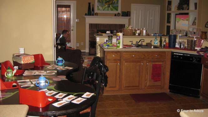 If you look closely you will see the stuff that is everywhere.  Muddy looking footprints adorn the quad table, dirty dishes litter the counter tops, and behind the counter toys fill the floor.