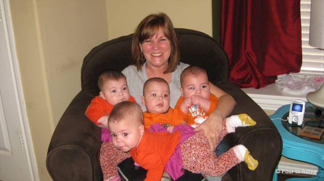 Even Nisey is juggling all four babies in her lap.  Clearly she ran out of room!