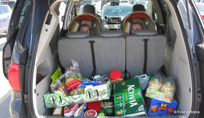 After shopping, we loaded all babies then the groceries into the van.  I always felt bad that the boys have to sit in the back, but I think they have a much better view than the girls.
