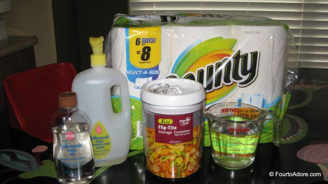 We use: a roll of select a size paper towels (so far Bounty is our preferred brand), 1.5 tbs baby wash, 1 tbs baby oil, 3 c. water