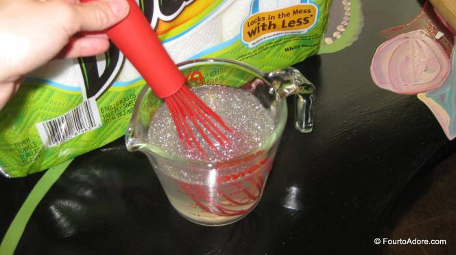 Whisk the 3 c. water, 1.5 tbs. baby wash, and 1 tbs baby oil together.