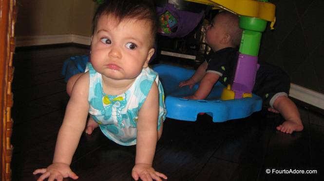 Harper discovered a new way to play with an Exersaucer, but Rylin was not impressed with his antics.