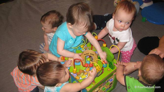 Some how all eight babies gravitated to this toy at once!  Amber and I took turns helping everyone stay balanced so the other could snap pictures.