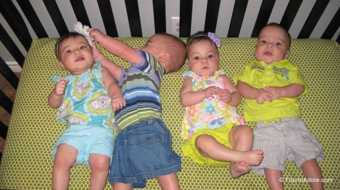 i lined the babies up in birth order for their monthly birthday picture.  This is what happened.