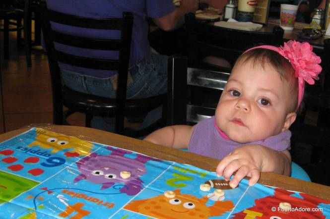 Sydney looked so tiny sitting at the table.  She had to stretch her arms and fingers out just to reach the Cheerios.