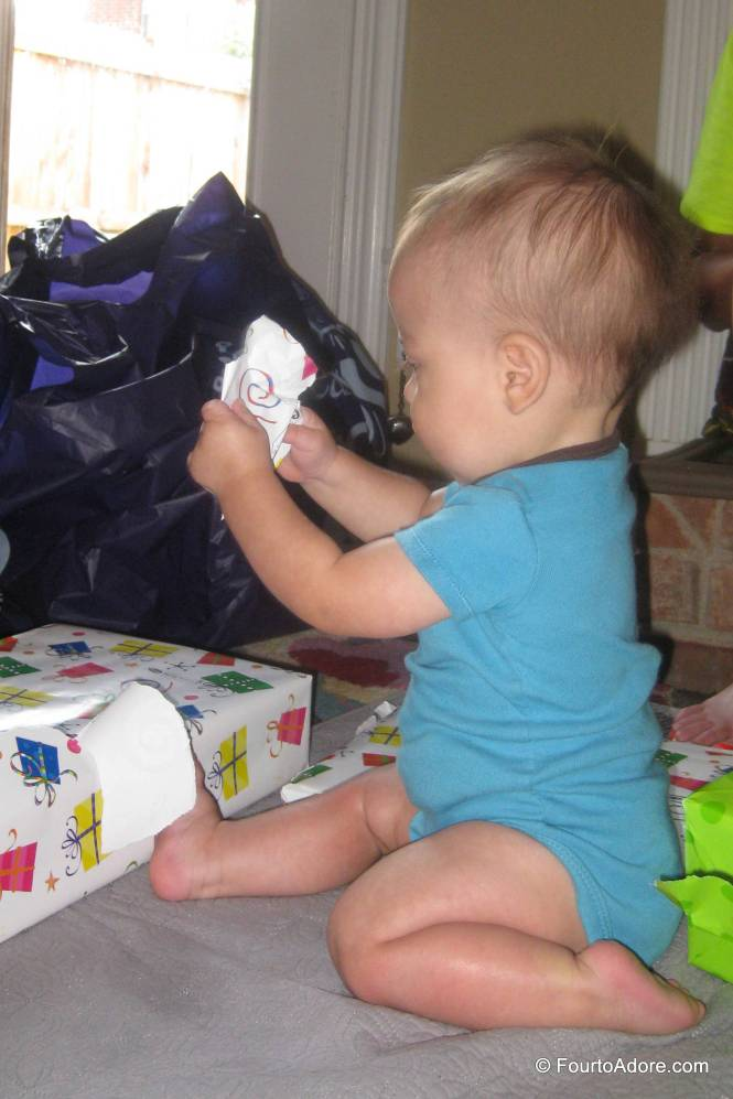 In no time, Mason figured out how to pull the edges off the bright packages.