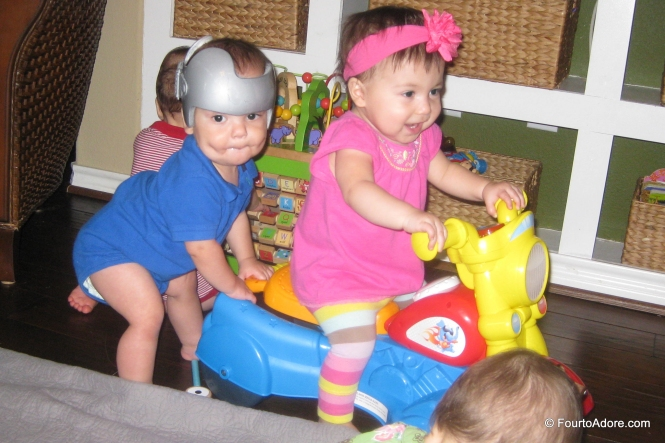 Rylin discovered how to get onto the motorcycle independently, and Mason decided he'd give her a push.  So cute!