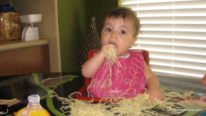 Rylin tackled spaghetti with reckless abandon!