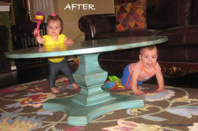 As soon as the table was complete and returned to it's rightful place in the den, Sydney began adding to the distressed finish with a maraca.