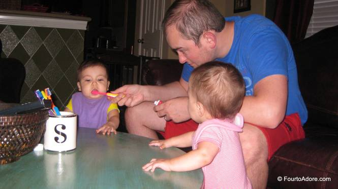 We brush the babies teeth first to ensure the job is sufficiently done.
