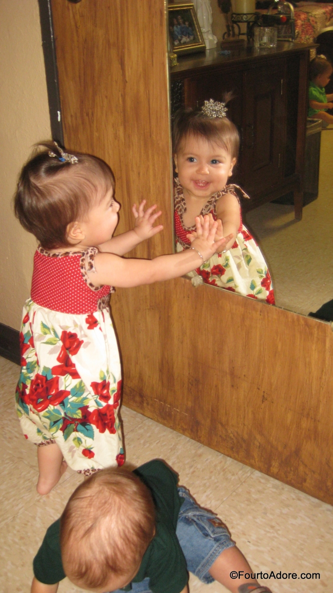 After our visit in the dining room, we let the babies loose in Grandmas room to burn off some energy.  Oh how the babies LOVE seeing their reflection in a mirror.  When they spotted Grandma's mirror, they each darted to it.