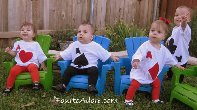 I'm sure everyone is tired of hearing this, but taking a picture of four active toddlers together is nearly impossible!  We busted out the baby Adirondack chairs to contain them, but Mason kept escaping.
