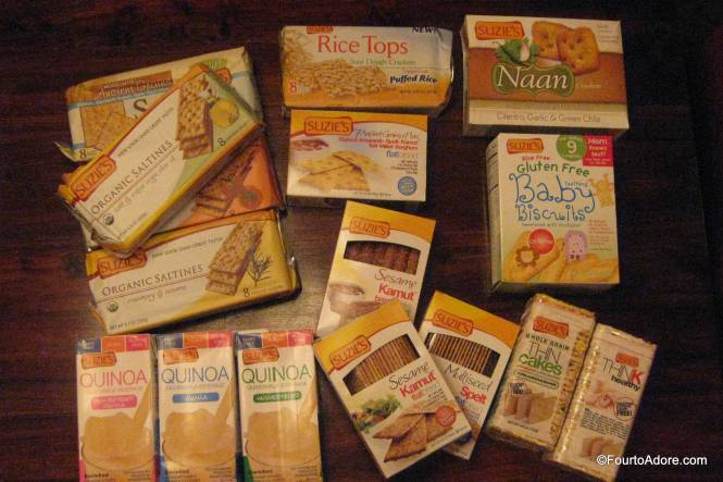 Our shipment included: cilantro naan crackers, plain unsweetened quinoa milk, vanilla sweetened quinoa milk, vanilla unsweetened quinoa milk, sesame kamut flatbread, ancient grain flatbread, breadsticks, olive oil crackers, rosemary sesame crackers, tomato oregano crackers, sourdough puffed rice crackers, ancient multigrain crackers, baby biscuits, thin cakes with sesame, and salted thin cakes.