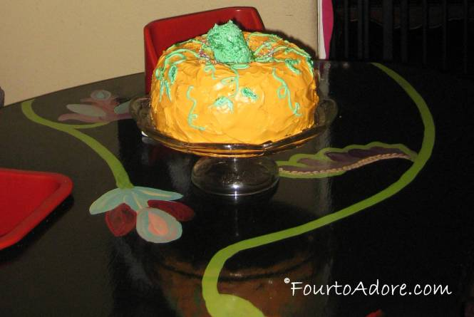 When I was a kid, mom always made a pumpkin shaped cake of two bundt cakes.  She made it once again for the quads.
