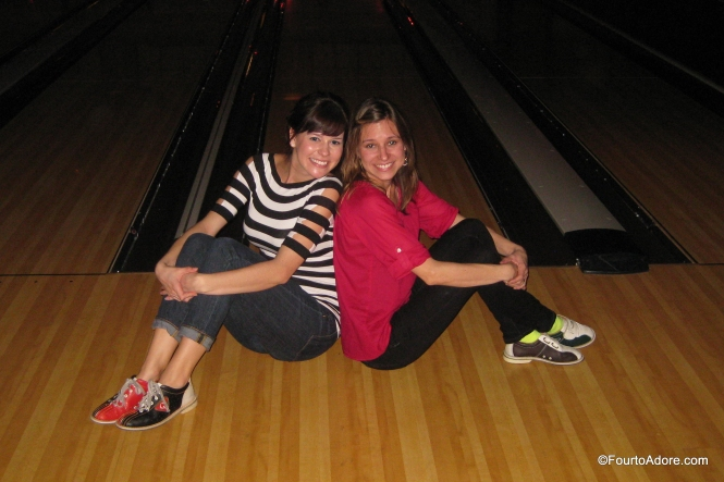 Courtney and I took a cheesy sister picture, which reminded me of a middle school volleyball team photo.  Notice I have super dorky bowling shoes thanks to miniature feet.  I think they gave me a kid's pair.