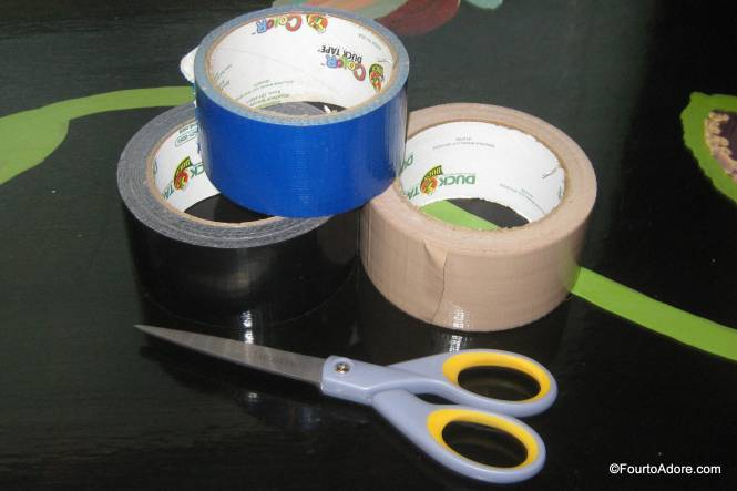 To fix them, I gathered our collection of Duct tape and a pair of scissors.