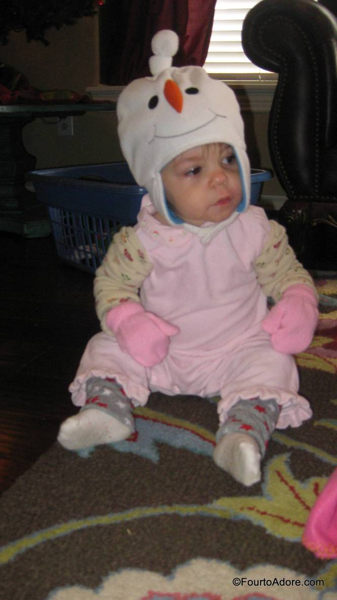 Everyone was already wearing a romper and socks.  I put a pair of Baby Legs under their romper and on their amrs, then I added hats, and fleece pajamas.  Bam! Texas style baby snow suits.  The best part was not dealing with shoes.