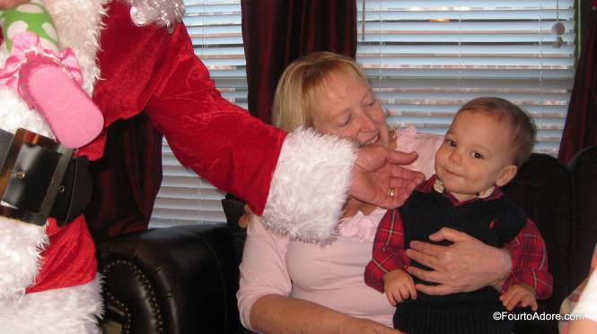 Santa couldn't help but pinch Mason's adorable cheeks.