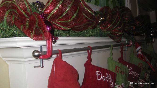 "In order to hang so many stockings, and ""quad proof"" them, we used a curtain rod and three industrial clamps.  The quads have done well with using their eyes to see and not touching, but the rod is really strong if they ever pull one."