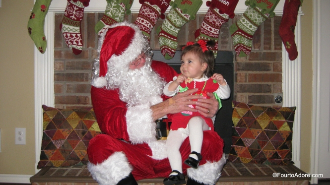 Rylin was the only one hesitant to sit on Santa's lap.  A cookie did the trick.