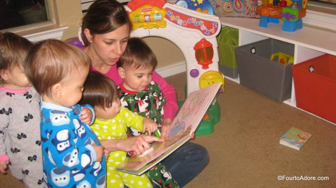 It's not easy, but I love it when all four babies pile up in my lap for stories.  I'll keep cramming them in as long as possible.