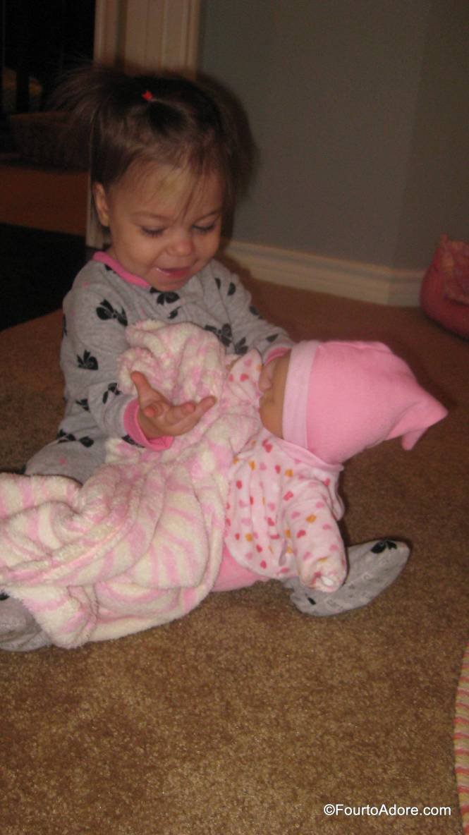 """Sydney is finally  starting to engage in pretend play.  She and Rylin have been feeding and rocking their """"twin"""" babies all week."""
