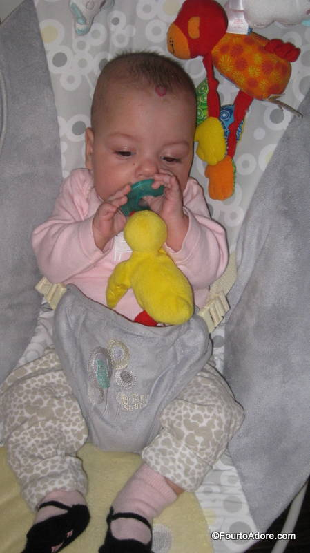 Sydney fell in love with her Wubbanub in the NICU, and   continued to love it after she came home.