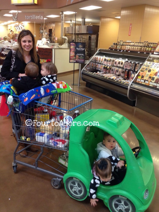 Our neighborhood Kroger has carts which seat all four babies.  Scoring one of these sweet rides usually involves me stalking the cart corral, however.