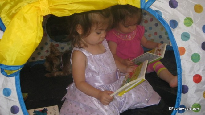 "Indoor tents made the perfect refuge for reading on a rainy day.   Notice Rylin's ""Elsa dress"", she wears it almost daily."