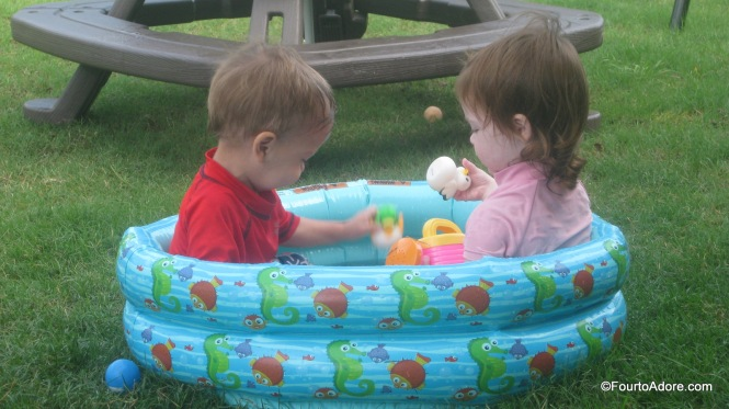 Mason and Trystan cozied up in the mini pool.