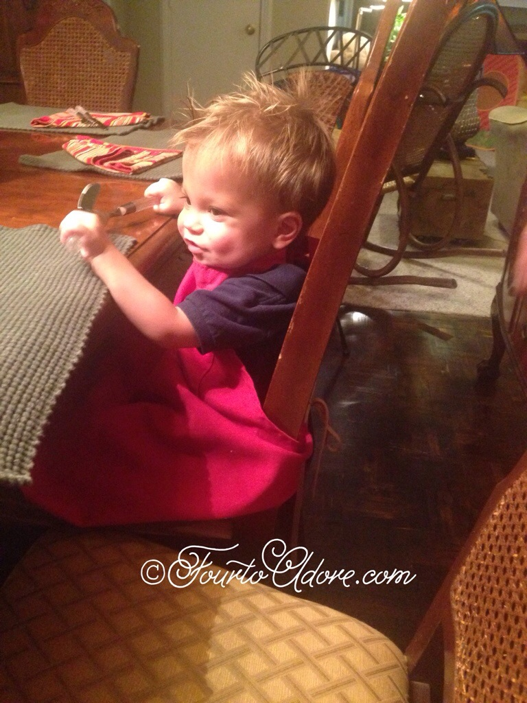 Use an apron and a pillow/ cushion/ phone book to make a booster seat when eating away from home with toddlers.