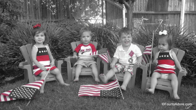 I realize it's not kosher to allow an American flag to touch the ground...but with four almost two year olds around, they may have grazed the ground a bit.  Please forgive us.