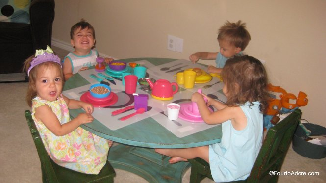 The four pack practiced setting their table for tea time.  They served quite the spread of plastic food.