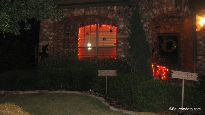 fall porch decor: orange lights plastic bats