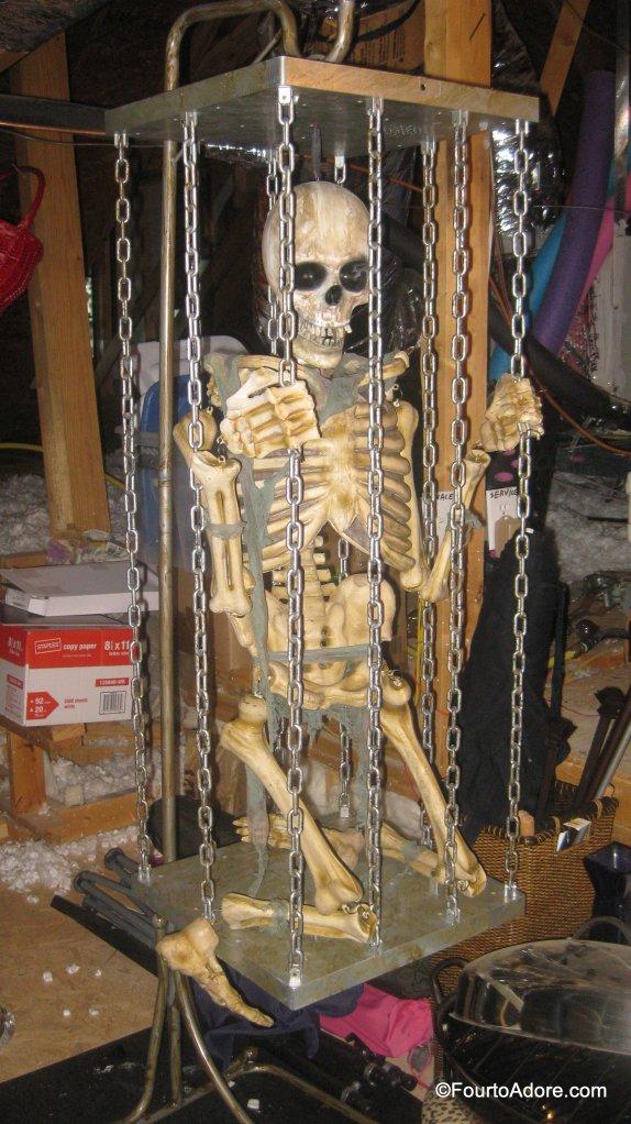 Halloween decoration, life size caged skeleton
