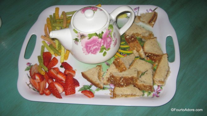 toddler tea party: lemon honey decaf tea, pb & j sandwiches, strawberries, veggie straws