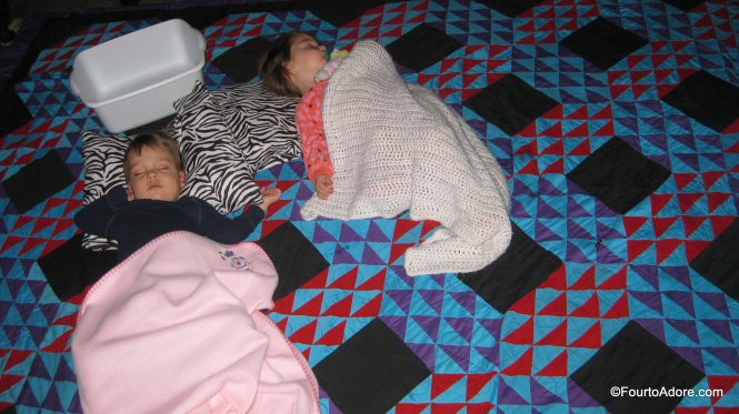 lay a quilt on the floor for sick toddlers