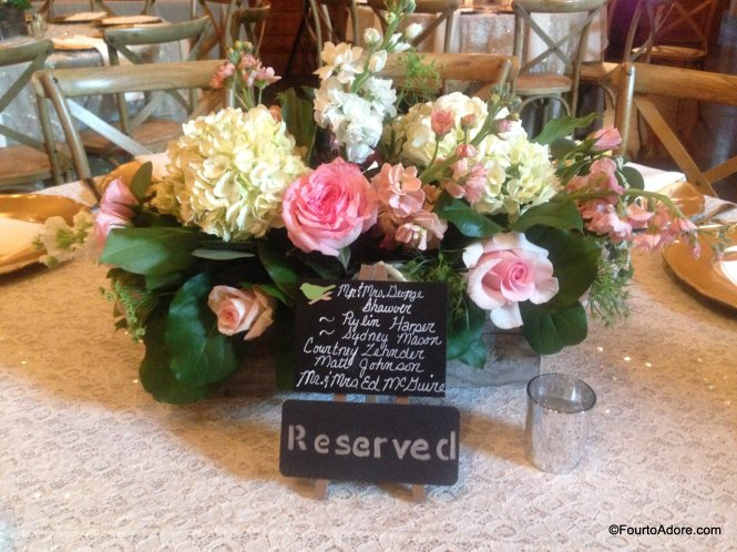 reserved seating signs and flower arrangement