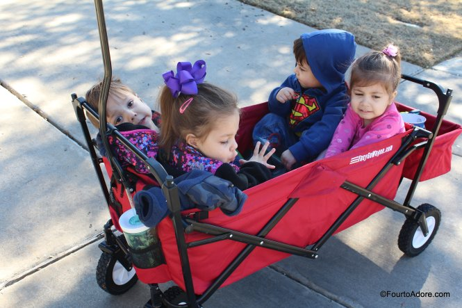 quadruplets in the foldable wagon